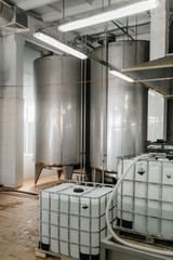 Production of milk and yogurt at the plant. Metal units and tanks for storage and transportation.
