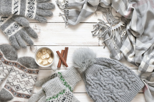 Warm woolen knitwear and cocoa with marshmallow