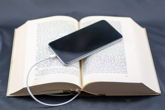 ebook - open book and phone
