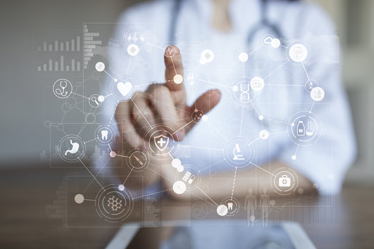 Medical doctor working?with modern computer virtual screen interface. Medicine technology and healthcare concept.
