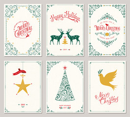Ornate vertical winter holidays greeting cards with New Year tree, reindeers, Christmas ornaments, dove, swirl frames and typographic design.