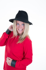 middle aged woman fashion model in warm wool red clothes posing with black hat in white background