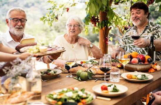 Big family having dinner at the veranda