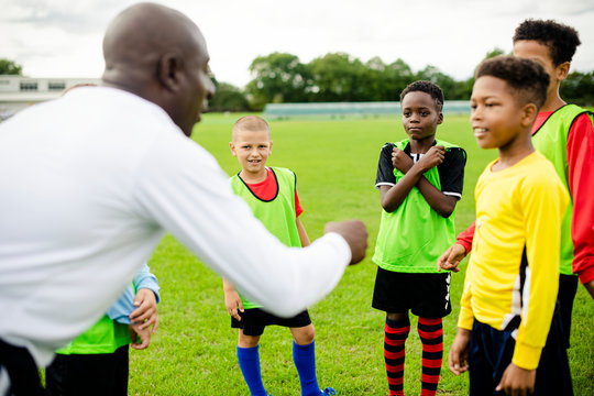 Football coach instructing his students