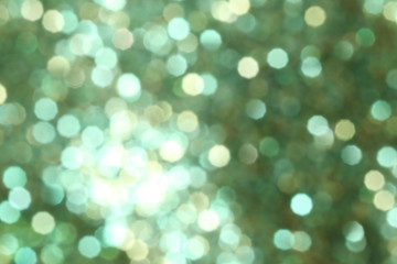 Christmas abstract green bokeh background with light color in blur.