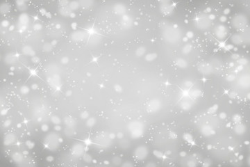 Light blurred abstract background with snow.