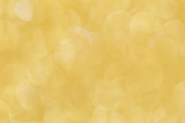 Christmas abstract gold bokeh background with light color in blur.