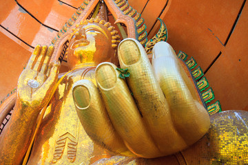 Closeup of hand big golden Buddha statue at Wat Tham Suea Kanchanaburi, Thailand.