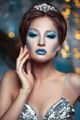 Beauty portrait of a beautiful woman with creative makeup in the image of the Snow Queen.