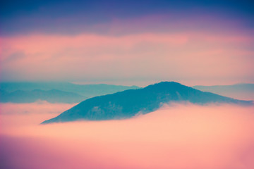 Sunset clouds above Apennine mountains in Italy. Nature landscape
