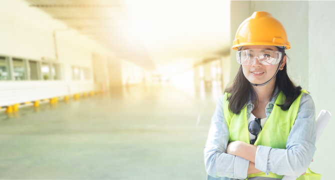 Double exposure of Woman engineering wearing yellow helmet and working at factory site