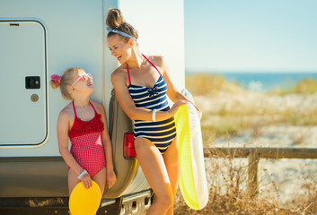 mother and child with yellow inflatable lifebuoy looking at each