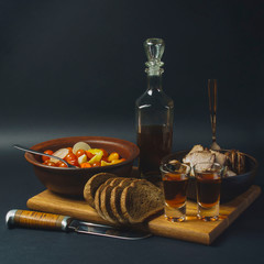 food photo smoked meat pickled tomatoes bread and brandy