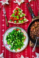 Christmas dinner lunch healthy food on red tablecloth with vegetables