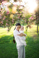Portrait Beautiful Mother And Baby outdoors. Nature. Beauty Mum and her Child playing in Park