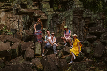 Group of tourists in the ruins of the temple  Ta Prohm.