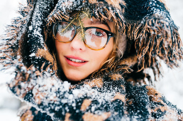 Unusual cute girl creative lifestyle fashion pottrait. Odd strange lovely funny woman in glasses. Graceful beatiful female smiling sensual face. Bizzare rebel lady wearing winter clothes. Snowy scarf.