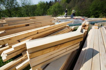 Pile of cut and prepared wood planks, beams and pieces
