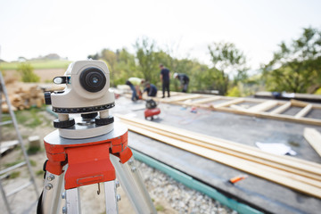 Theodolite measuring angles and positions at build site