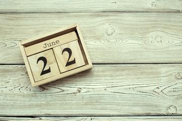 June 22nd. Image of june 22 wooden color calendar on wooden background. Summer day