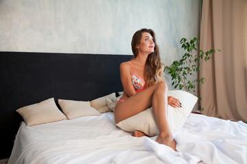 fashion portrait of a beautiful woman in underwear home in bedroom