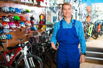 man in uniform working in bicycle shop .
