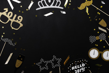 Table top view of Merry Christmas decorations & Happy new year 2019 ornaments concept.Flat lay essential difference objects to party season the photo booth prob on modern wooden black background.