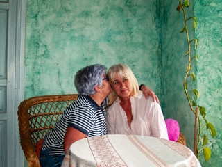 Two women sisters hugging smiling and showing happiness