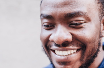 Black guy. Close-up face portrait. African American cheerful smiling man. Racial equality, photogenic, joy on the face