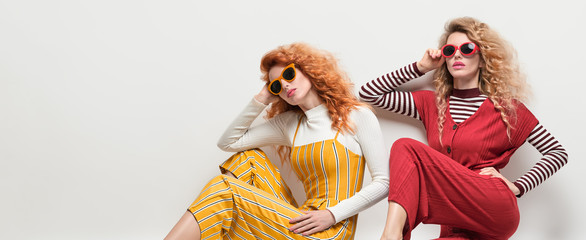 Wall Mural - Two Gorgeous Girl in Fashion Outfit. Curly Hair