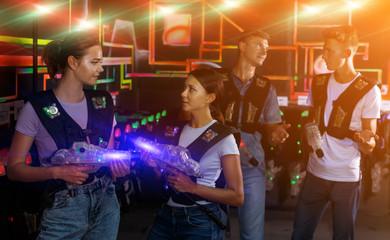Two girls talking during laser tag game