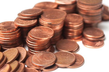 closeup of cents of euro coins piles on white background