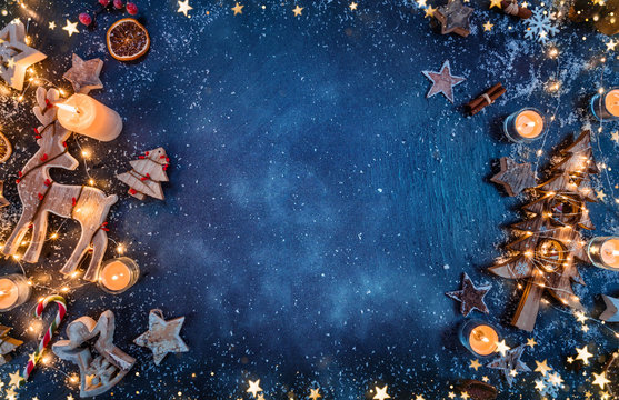 Christmas background with wooden decorations and candles. Free space for text.