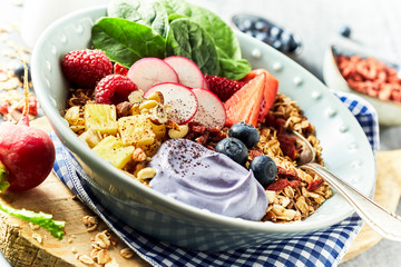 Bawl of muesli with berries in rustic style