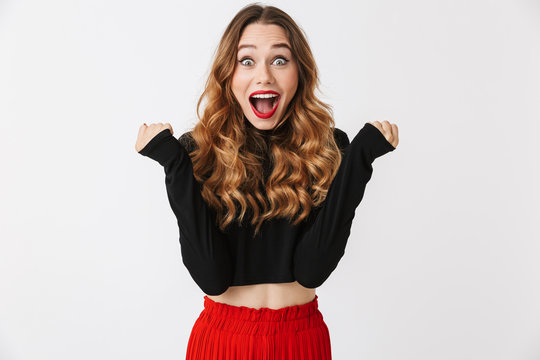 Portrait of an excited pretty young woman
