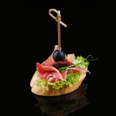 Photo sur Aluminium Entree Appetizer isolated on black background