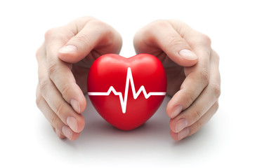 Red heart with pulse covered by man's hands.