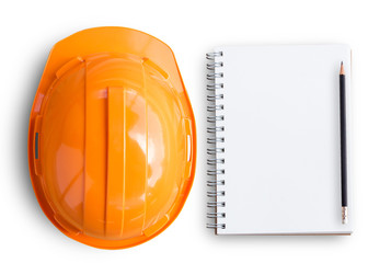 Top view with orange safety engineer helmet and blank notebook or notepad and pencil on white background