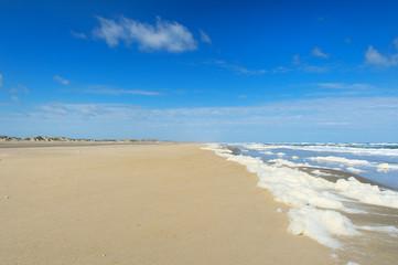 Empty beach with foam