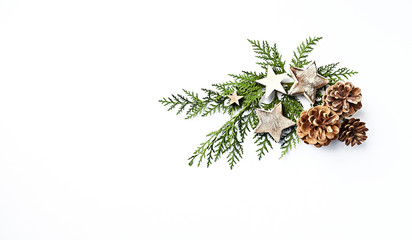 An arrangement of evergreen twigs and Christmas decorations. Flatlay. Copy space. White background