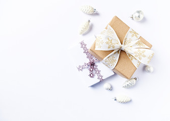 Christmas presents with decorations on white background. Flatlay. Copy space