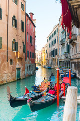 Photo sur Aluminium Venise VENICE, ITALY- December 21, 2017 : Tourists on water street with Gondola in Venice,ITALY
