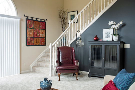 Living Room Staircase with Black Accent Wall