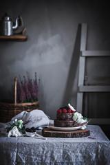 Chocolate cake on plate on wood stays
