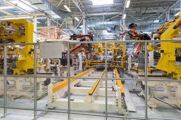 process of welding cars. Modern Assembly of cars at plant. automated build process of car body