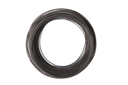 Coil of galvanized wire isolated on white background. Stack of black galvanized metal wire.