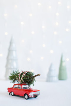 Red toy car with a christmas tree on the roof
