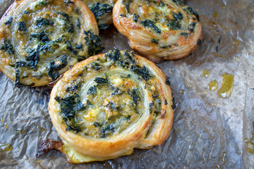 Baked spinach pinwheel puff pastries flat lay