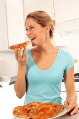 GIRL EATING DANISH PASTRIES