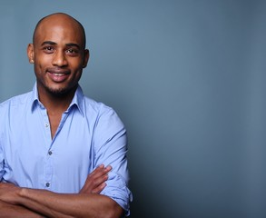 Black man in front of a colored background